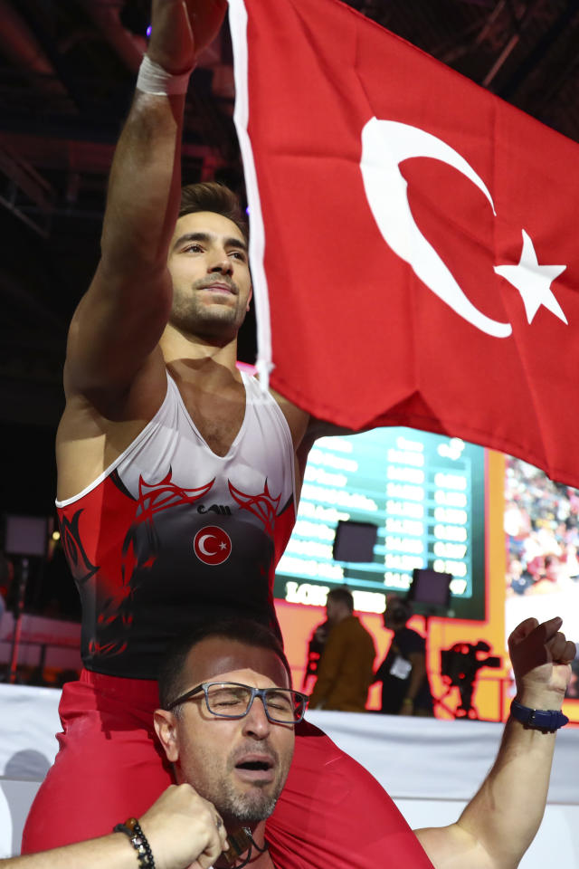 Gold medalist Ibrahim Colak of Turkey celebrates after his performance in the men's rings exercise during the apparatus finals at the Gymnastics World Championships in Stuttgart, Germany, Saturday, Oct. 12, 2019. (AP Photo/Matthias Schrader)