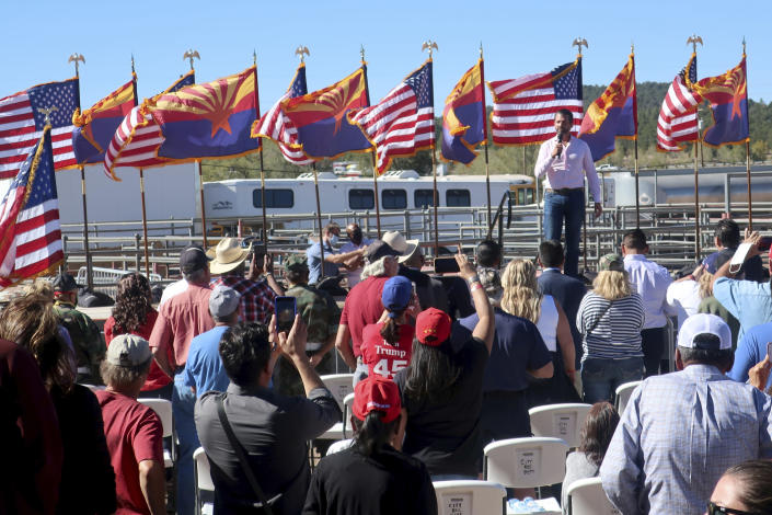 Donald Trump Jr. speaks at an Oct. 15, 2020, rally for his father, President Donald Trump, at the rodeo grounds in Williams, Arizona. Navajo Nation President Myron Lizer makes no qualms about it: As one of the top officials on the country's largest Native American reservation, he's a proud Donald Trump supporter. The Navajo Nation vice president says Native American values - hard work, family and ranching - align more with the GOP than with Democrats. (AP Photo/Felicia Fonseca)