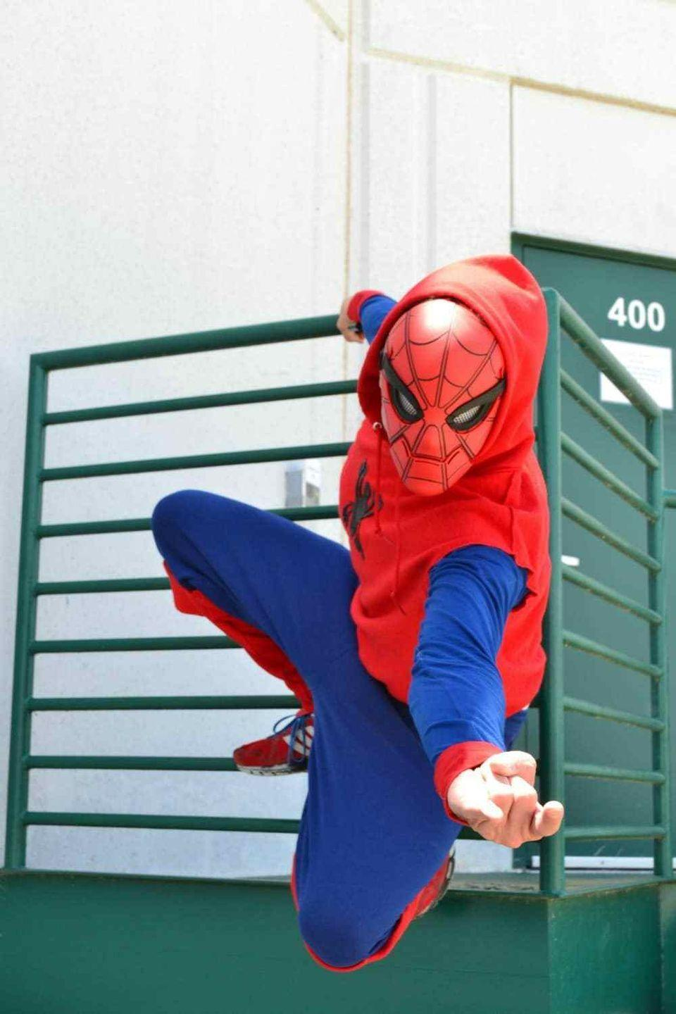 "<p>No need to get caught in a web of thread! This crafty costume requires absolutely no sewing.</p><p><strong>Get the tutorial at <a href=""https://lifeshehas.com/spider-man-homecoming-diy-costume-challenge/"" rel=""nofollow noopener"" target=""_blank"" data-ylk=""slk:Life She Has"" class=""link rapid-noclick-resp"">Life She Has</a>.</strong></p><p><strong><a class=""link rapid-noclick-resp"" href=""https://www.amazon.com/Kid-Nation-Fleece-Pullover-Sweatshirt/dp/B0778GR2SV/?tag=syn-yahoo-20&ascsubtag=%5Bartid%7C10050.g.21345654%5Bsrc%7Cyahoo-us"" rel=""nofollow noopener"" target=""_blank"" data-ylk=""slk:SHOP SWEATSHIRT"">SHOP SWEATSHIRT</a></strong></p>"