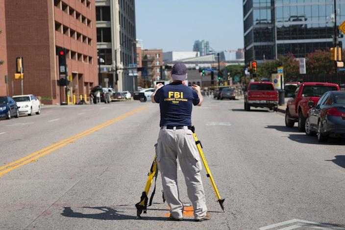 FBI and police investigate the site of a shooting on July 8, 2016, in Dallas Texas (AFP Photo/Laura Buckman)