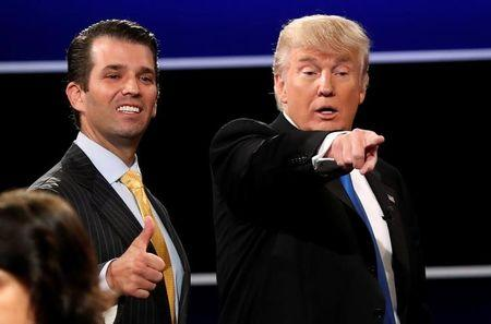 Donald Trump Jr. gives a thumbs up beside his father Donald Trump after presidential debate in Hempstead, New York