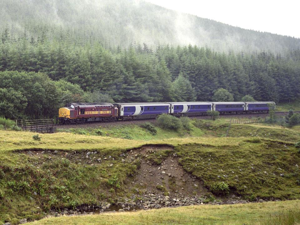 Caledonian Sleeper from London Euston Station approaching the Horseshoe Curve on the West Highland Line (Getty)