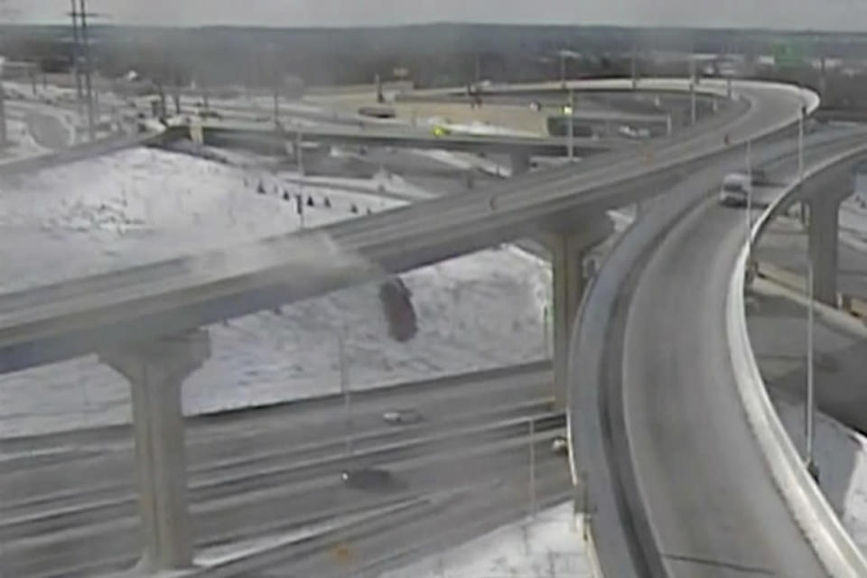 In this Saturday, Feb. 6, 2021 image from video made available by the Wisconsin Department of Transportation, a pickup truck falls off an elevated highway in Milwaukee. After plunging about 70 feet (21 meters) off the slippery interchange exit ramp, Richard Lee Oliver said he feels thankful to be alive. (Wisconsin Department of Transportation via AP)