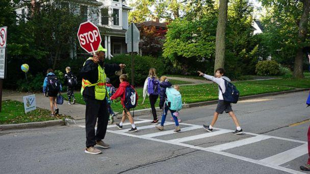 PHOTO: On Sept. 10, 2019, Alec Childress was met with 100 kids, parents, family and church members at the intersection where he's been crossing students in Wilmette, Illinois, for 14 years. (Courtney Greve Hack)