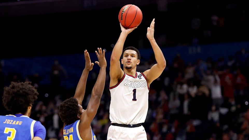 INDIANAPOLIS, INDIANA - APRIL 03: Jalen Suggs #1 of the Gonzaga Bulldogs shoots a game-winning three point basket in overtime to defeat the UCLA Bruins 93-90 during the 2021 NCAA Final Four semifinal at Lucas Oil Stadium on April 03, 2021 in Indianapolis, Indiana. (Photo by Jamie Squire/Getty Images) ORG XMIT: 775630334 ORIG FILE ID: 1310685378