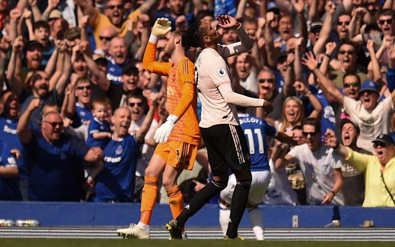 David De Gea and Chris Smalling show their frustration after Theo Walcott scores Everton's fourth - AFP