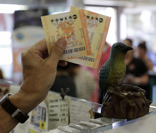 <p>A man shows his Powerball lottery tickets at the Bluebird Liquor store in Hawthorne, Calif., on Aug. 23, 2017. The Powerball lottery has risen to 700 million US dollars making it one of the largest in history. Aug. 23, 2017. (Photo: Mike Nelson/EPA/REX/Shutterstock) </p>