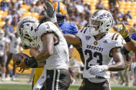 Western Michigan cornerback Dorian Jackson (23) celebrates with linebacker Zaire Barnes (3) after Barnes recovered a Pittsburgh fumble during the first half of an NCAA college football game, Saturday, Sept. 18, 2021, in Pittsburgh. (AP Photo/Keith Srakocic)