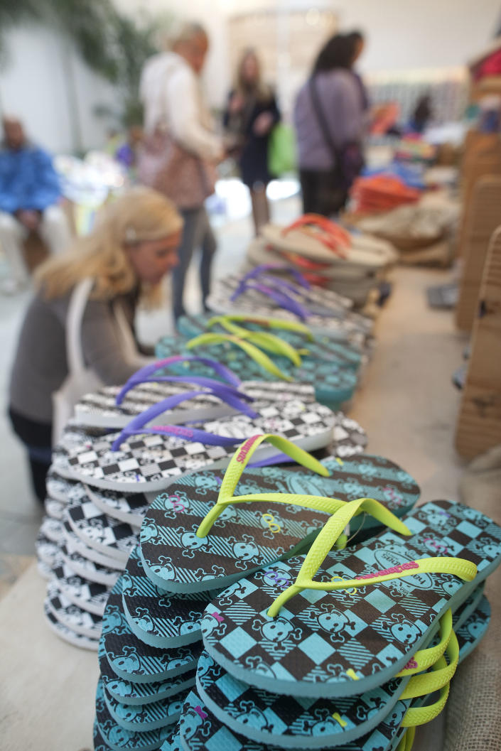 In this photo taken July 16, 2012, Havaianas sandals sit for sale at a store in Sao Paulo, Brazil. In Brazil, literally everyone wears Havaianas, the now world-famous brand of rubber and plastic flip-flops that's celebrating its 50th birthday this year. (AP Photo/Andre Penner)