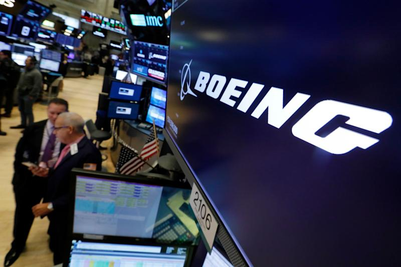 The logo for Boeing appears above a trading post on the floor of the New York Stock Exchange, Wednesday, Oct. 24, 2018. Stocks are off to a mixed start on Wall Street as gains for Boeing and other industrial companies are offset by losses elsewhere in the market. (AP Photo/Richard Drew)