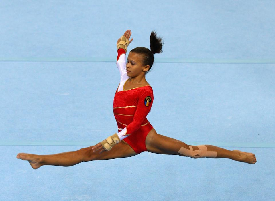 Diana Bulimar, 16, of Romania competes in the Women's floor final on day eight of the Singapore 2010 Youth Olympics at Bishan Sports Hall on August 22, 2010 in Singapore. (Mark Dadswell/Getty Images)