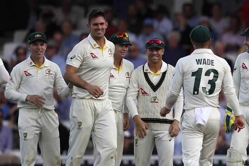 Australia's Mitchell Marsh (2L) celebrates with teammates after taking the wicket of England's Chris Woakes for two during play on the first day of the fifth Ashes cricket Test match between England and Australia at The Oval in London on September 12, 2019. (Photo by Adrian DENNIS / AFP) / RESTRICTED TO EDITORIAL USE. NO ASSOCIATION WITH DIRECT COMPETITOR OF SPONSOR, PARTNER, OR SUPPLIER OF THE ECB (Photo credit should read ADRIAN DENNIS/AFP/Getty Images)