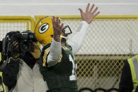 Green Bay Packers quarterback Aaron Rodgers celebrates his one-yard touchdown run during the first half of an NFL divisional playoff football game against the Los Angeles Rams, Saturday, Jan. 16, 2021, in Green Bay, Wis. (AP Photo/Morry Gash)