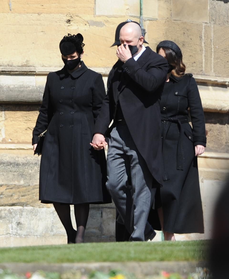 WINDSOR, ENGLAND - APRIL 17: Zara Tindall and Mike Tindall arrive for Prince Philip, Duke of Edinburgh's funeral at Windsor Castle on April 17, 2021 in Windsor, United Kingdom. Prince Philip of Greece and Denmark was born 10 June 1921, in Greece. He served in the British Royal Navy and fought in WWII. He married the then Princess Elizabeth on 20 November 1947 and was created Duke of Edinburgh, Earl of Merioneth, and Baron Greenwich by King VI. He served as Prince Consort to Queen Elizabeth II until his death on April 9 2021, months short of his 100th birthday. His funeral takes place today at Windsor Castle with only 30 guests invited due to Coronavirus pandemic restrictions. (Photo by Mark Large-WPA Pool/Getty Images)