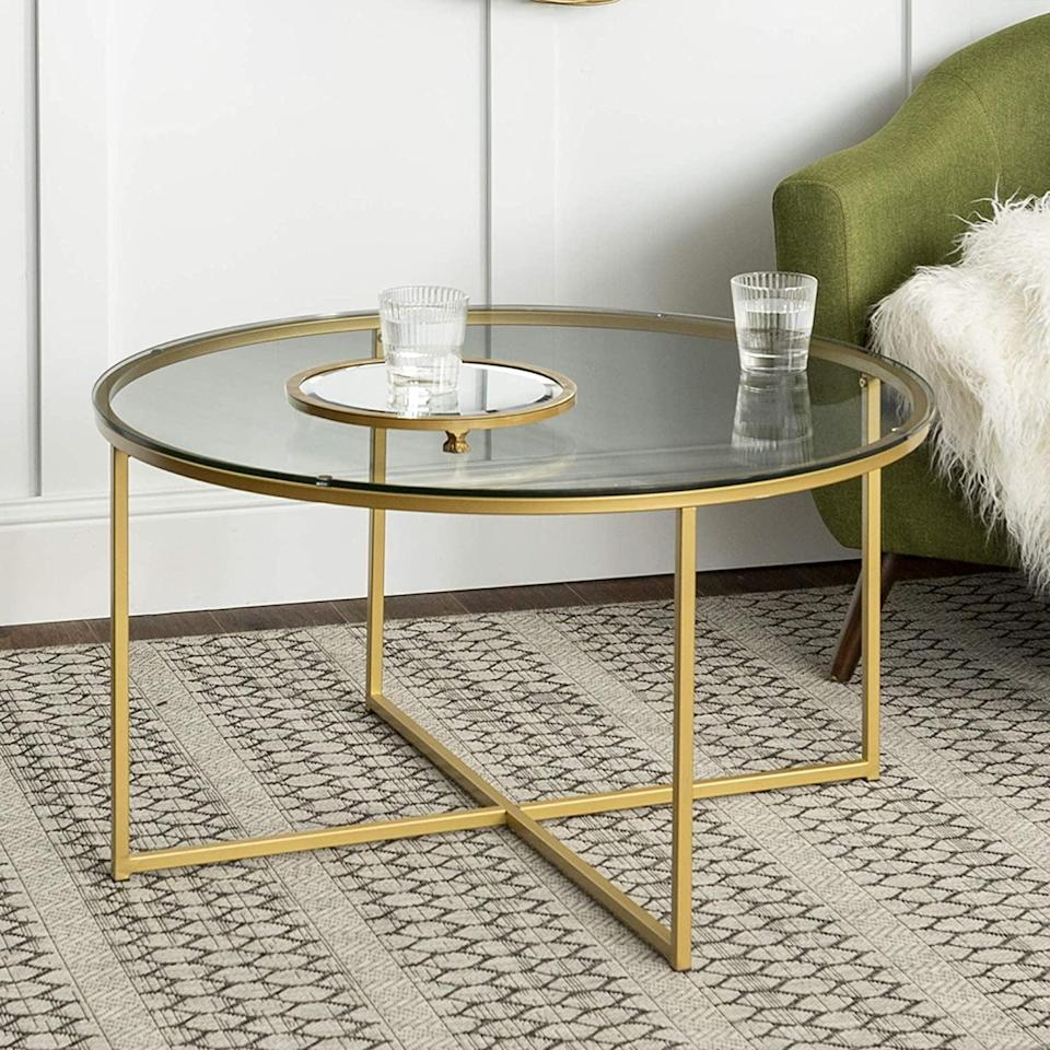 <p>Make your living room feel extra glamorous with this <span> WE Furniture Coffee Table </span> ($133). If you can't get enough, the line also features matching side tables.</p>