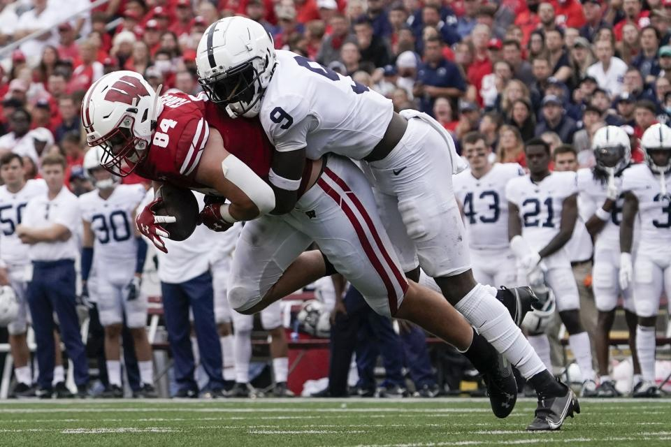 Wisconsin's Jake Ferguson catches a pass in front of Penn State's Joey Porter Jr. during the first half of an NCAA college football game Saturday, Sept. 4, 2021, in Madison, Wis. (AP Photo/Morry Gash)