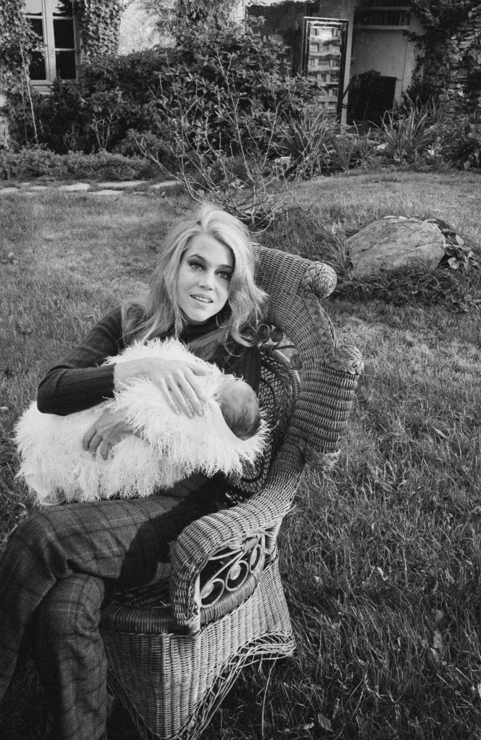 <p>New mother Jane Fonda spends the afternoon in the garden of her Paris home in 1968. The actress welcomed her daughter with husband Roger Vadim. </p>