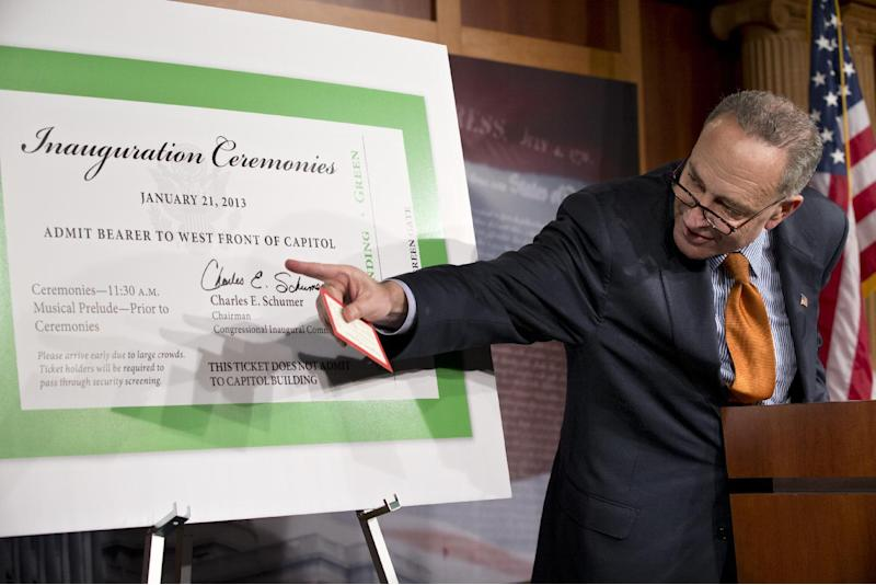 FILE -M This Jan. 14, 2013 file photo shows Sen. Charles Schumer, D-N.Y., chairman of the Joint Congressional Committee on Inaugural Ceremonies, displaying the official tickets, maps and access plans that will be distributed to people coming to see President Obama take the oath of office for his second term, during a press conference, on Capitol Hill in Washington. Schumer's office announced Thursday that eBay and Craigslist agreed to cancel the listings. The office said the StubHub website had already refused to sell Inaugural tickets. (AP Photo/J. Scott Applewhite)