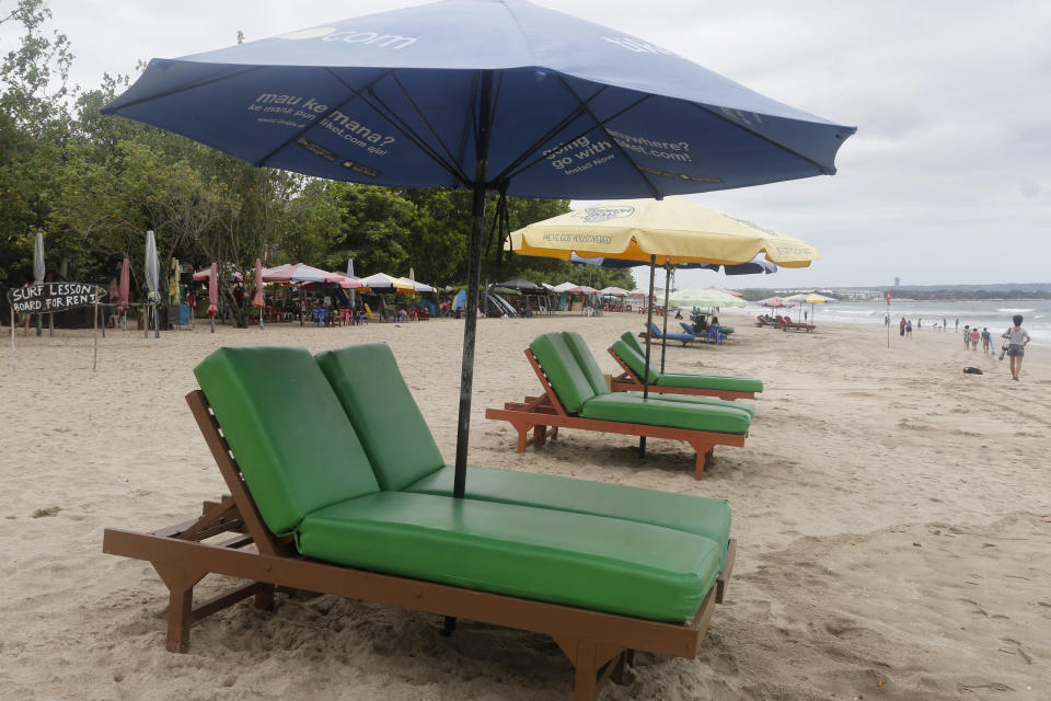 Empty sun chairs are placed at Kuta beach, Bali, Indonesia Wednesday, Oct. 6, 2021. Indonesia plans to reopen the airport in the resort island of Bali for international flights on Oct. 14, after closing it for more than a year because of the COVID-19 pandemic. (AP Photo/Firdia Lisnawati)