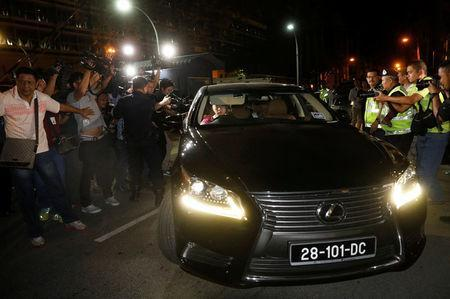Members of the media chase a North Korea official car to ask questions at the morgue at Kuala Lumpur General Hospital where Kim Jong Nam's body is held for autopsy in Kuala Lumpur, Malaysia February 15, 2017. REUTERS/Edgar Su