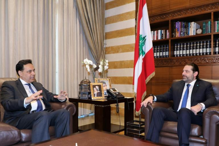 Lebanon's prime minister-designate Hassan Diab (L) has been holding consultations to form a new government needed to help the protest-hit country deal with mounting financial woes (AFP Photo/-)