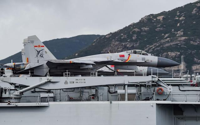 J-15 fighter jets are seen on the flight deck of China's sole aircraft carrier - AFP