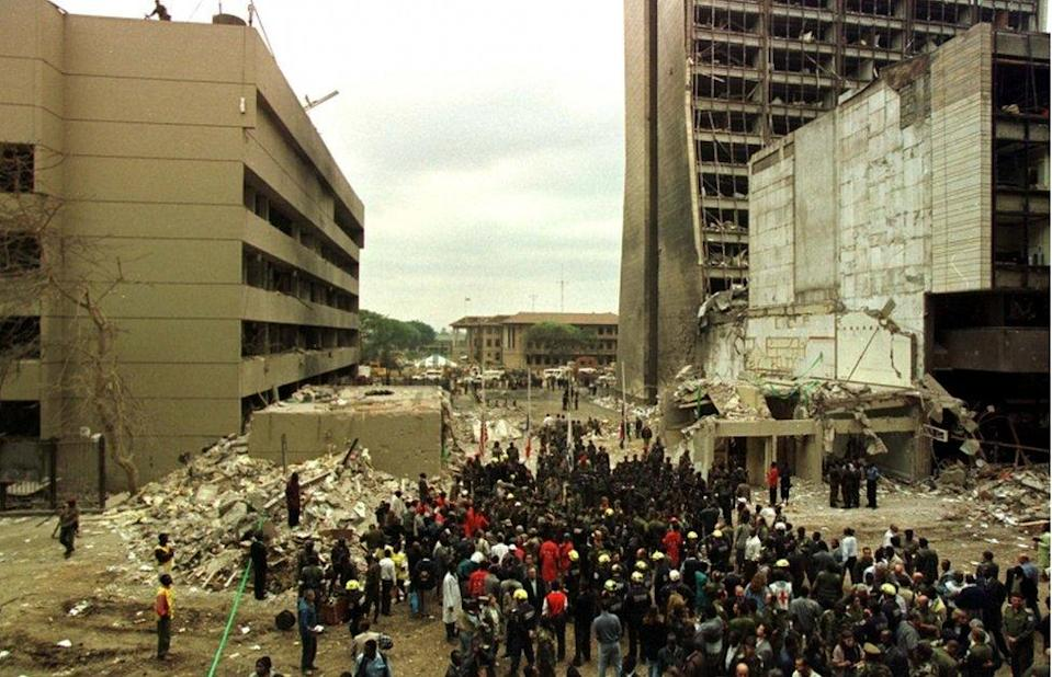 Crowds gather at a memorial ceremony held at the scene of the bombing of the U.S. Embassy building in Nairobi, Kenya on August 12, 1998