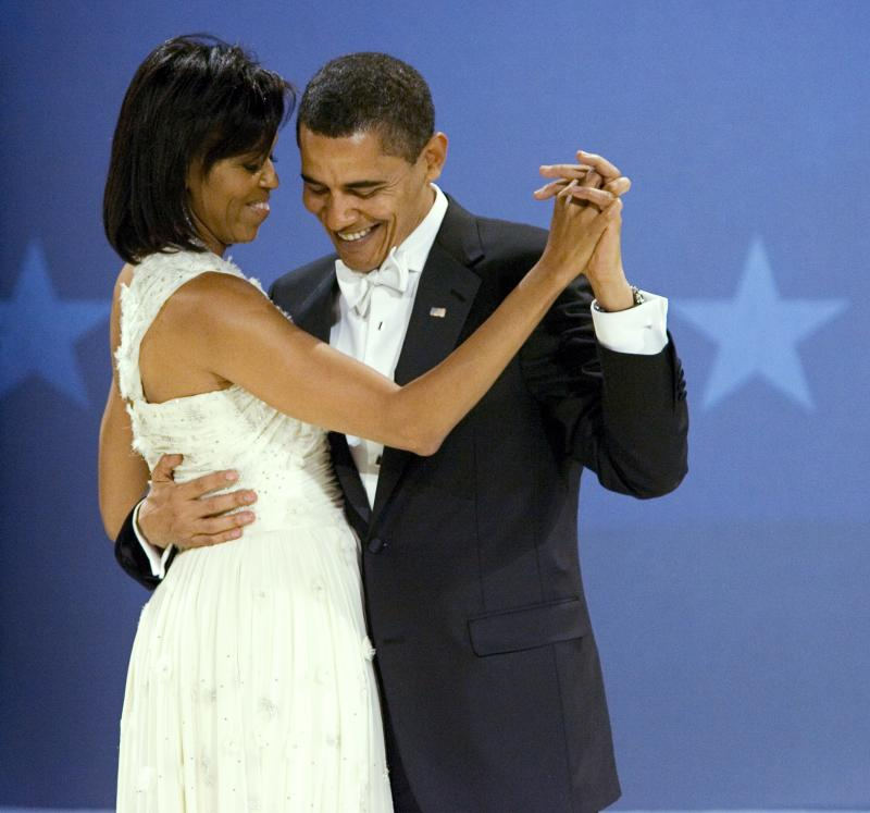 """FILE - In this Jan. 20, 2009, file photo President Barack Obama dances with first lady Michelle Obama at the Midwestern Ball on the night of his inauguration in Washington. Here's the first lady's advice for couples this Valentine's Day, Monday Feb. 14: laugh with your partner. She says it's what she and the president do, and it seems to be working. It also helps that her husband is """"very romantic"""".  (AP Photo/Manuel Balce Ceneta, File)"""