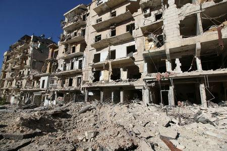 A general view shows the damage at a site hit by airstrikes in the rebel-held besieged al-Qaterji neighbourhood of Aleppo