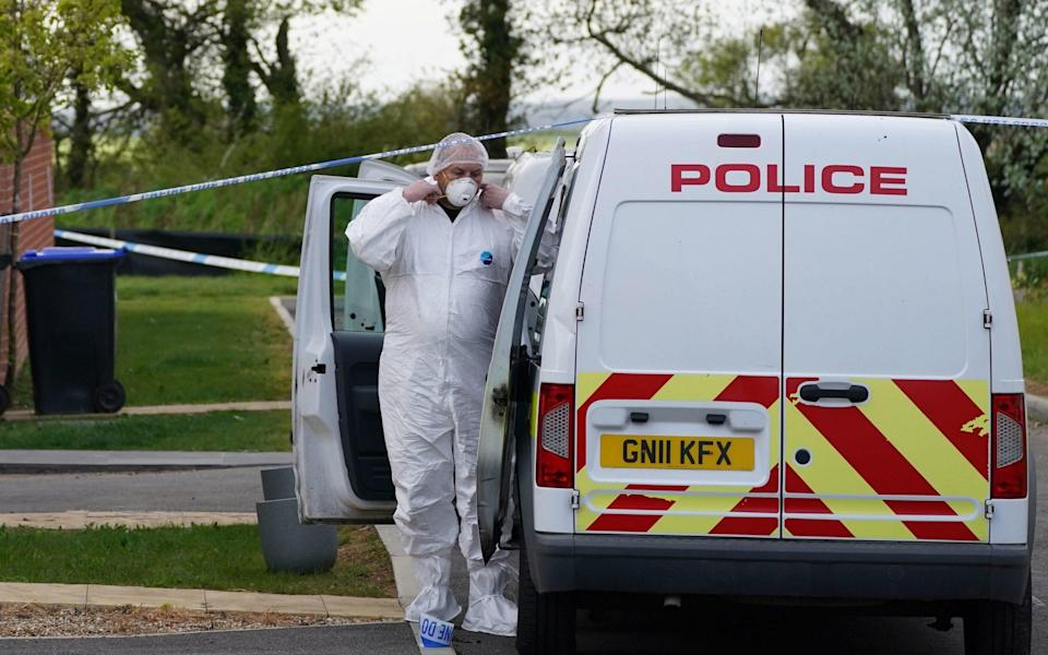 Forensic officers at an address in Aylesham, Kent, on Saturday - Steve Parsons/PA
