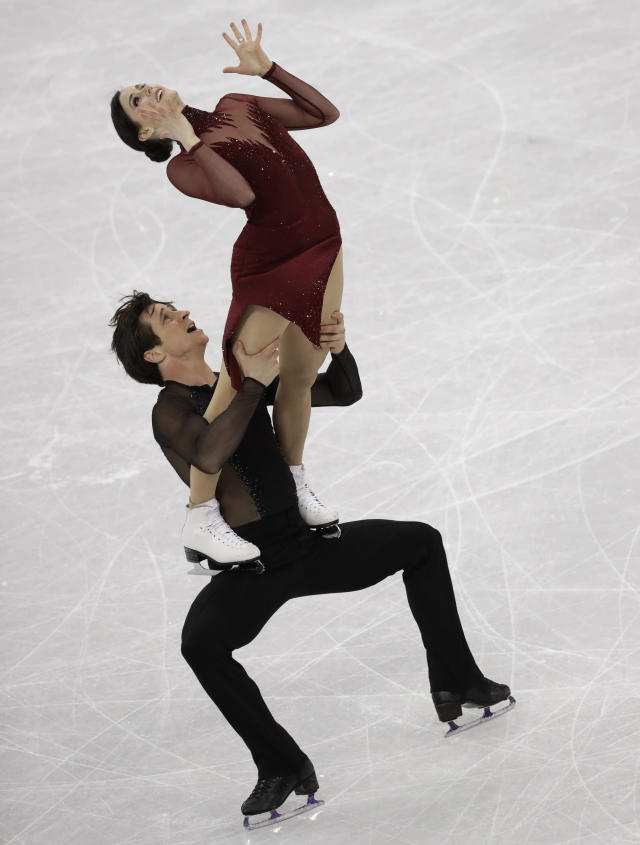 <p>Tessa Virtue and Scott Moir of Canada perform during the ice dance, free dance figure skating final in the Gangneung Ice Arena at the 2018 Winter Olympics in Gangneung, South Korea, Tuesday, Feb. 20, 2018. (AP Photo/Bernat Armangue) </p>