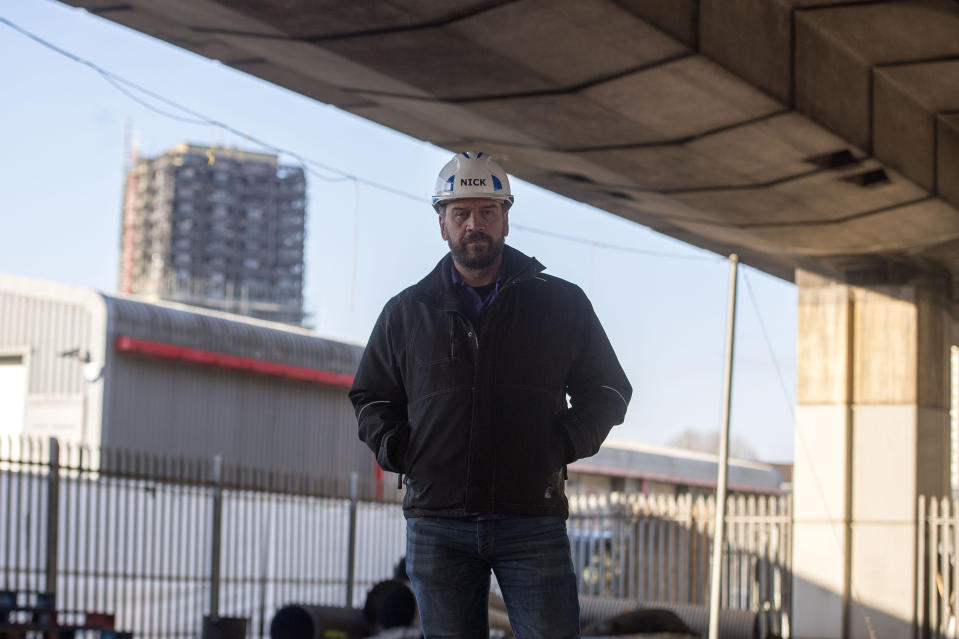 EMBARGOED TO 1200 MONDAY MARCH 26 BBC's DIY SOS Nick Knowles on the site of a brand new multi-use community space and gym that his team are building for the Grenfell community on a site underneath the A40.