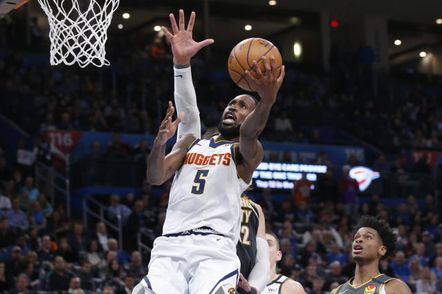 Denver Nuggets forward Will Barton (5) shoots in front of Oklahoma City Thunder center Steven Adams, rear, in the first half of an NBA basketball game Friday, Feb. 21, 2020, in Oklahoma City. (AP Photo/Sue Ogrocki)