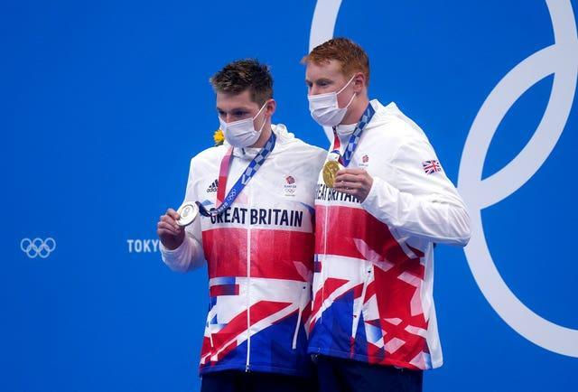 Dean, right, and Scott, left, are the first British male swimmers to share a podium since the 1908 London Games (Adam Davy/PA)