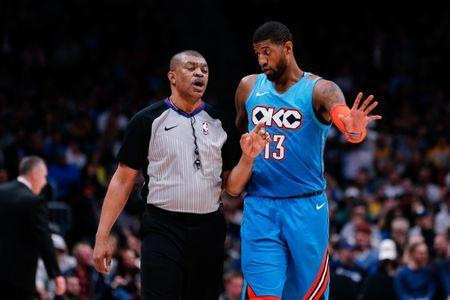 Feb 26, 2019; Denver, CO, USA; Oklahoma City Thunder forward Paul George (13) talks with referee Tony Brothers (25) in the third quarter against the Denver Nuggets at the Pepsi Center. Mandatory Credit: Isaiah J. Downing-USA TODAY Sports