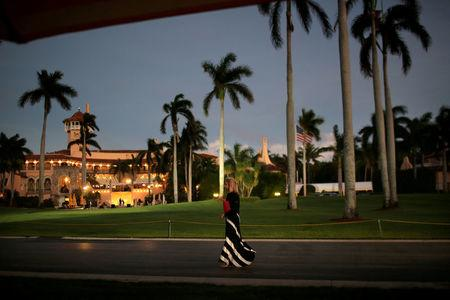 FILE PHOTO - A woman walks as she arrives at Mar-a-Lago estate where U.S. President-elect Donald Trump attends meetings, in Palm Beach, Florida, U.S.