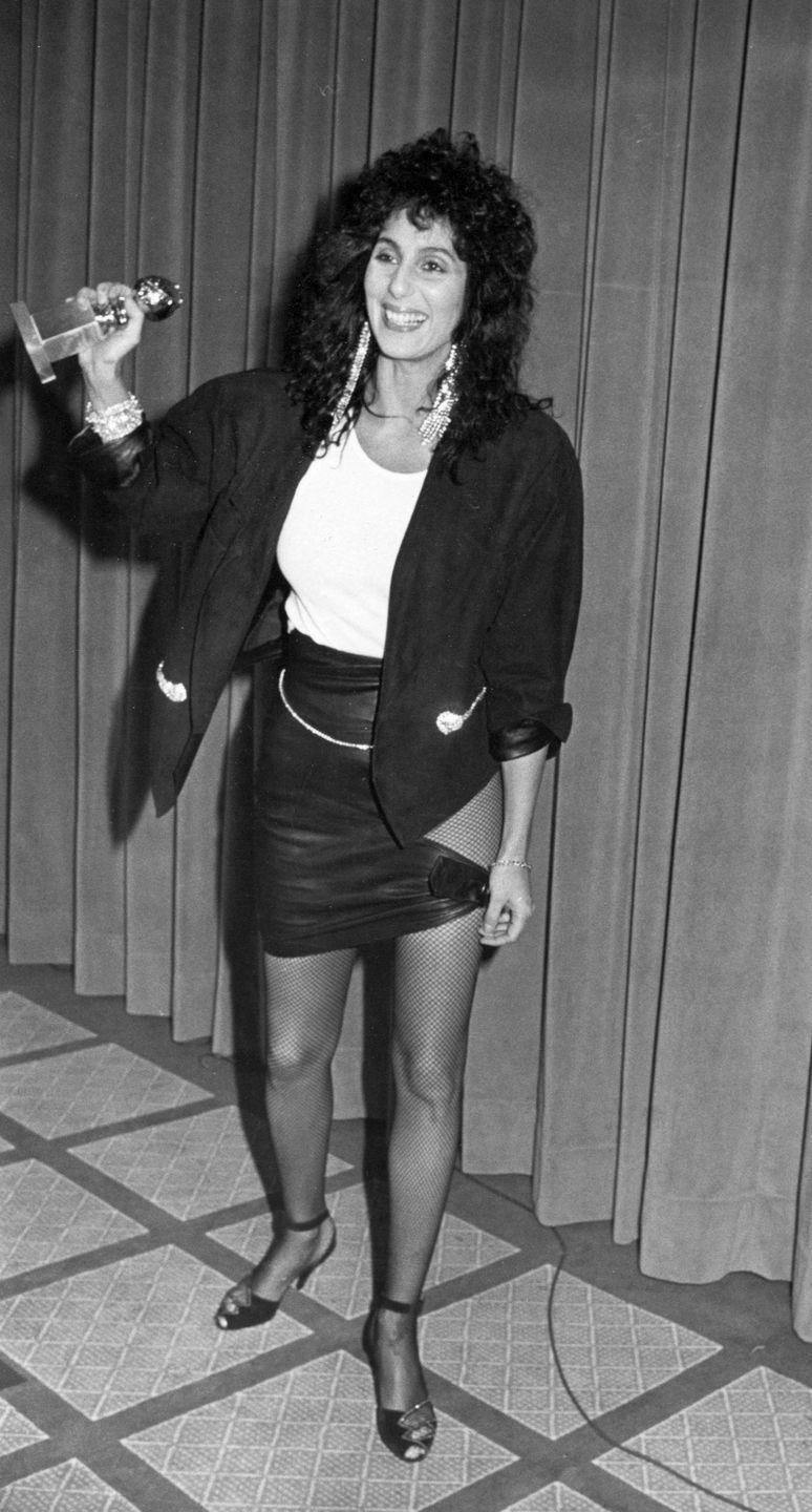 <p>Cher kept it cool and casual in a cutout miniskirt and fishnet stockings in 1984. </p>