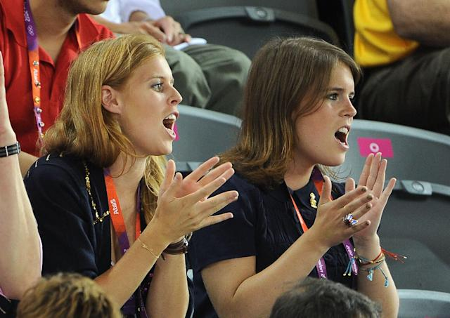 Princess Beatrice (L) and Princess Eugenie enkoy the atmosphere during Day 6 of the London 2012 Olympic Games at Velodrome on August 2, 2012 in London, England. (Photo by Pascal Le Segretain/Getty Images)