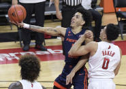 Illinois guard Andre Curbelo (5) shoots as he gets by Rutgers guard Geo Baker (0) during the first half of an NCAA college basketball game Sunday, Dec. 20, 2020, in Piscataway, N.J. (AP Photo/Bill Kostroun)