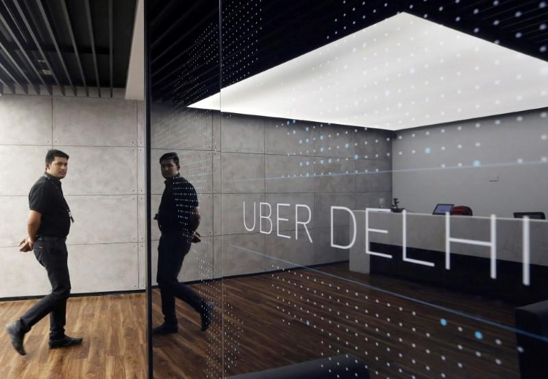 An employee walks at the office of ride-hailing service Uber in Gurugram