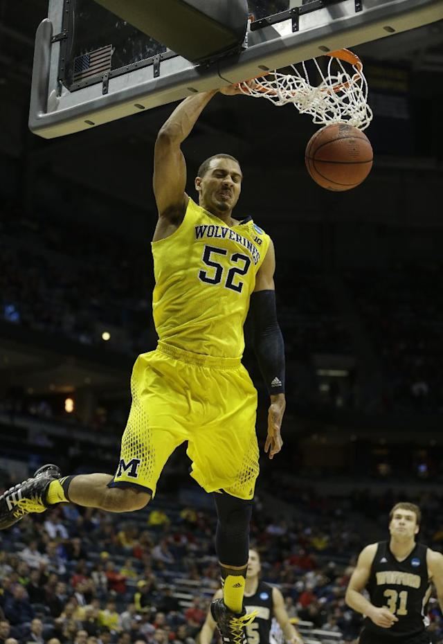 Michigan forward Jordan Morgan (52) dunks during the first half of a second round NCAA college basketball tournament game against the Wofford Thursday, March 20, 2014, in Milwaukee. (AP Photo/Morry Gash)