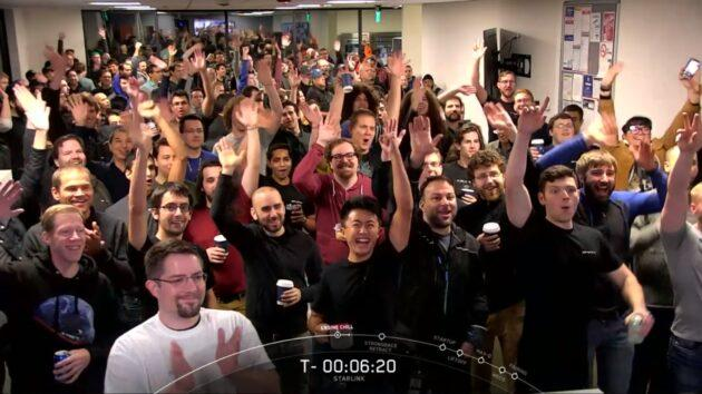 SpaceX employees in Redmond, Wash., give a cheer during the countdown to a Falcon 9 launch that put the company's second batch of 60 Starlink satellites into orbit last November. (SpaceX via YouTube)