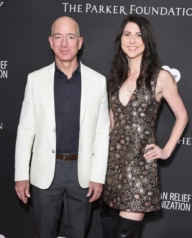 MacKenzie Scott, seen in a 2018 picture before her divorce with then-husband Jeff Bezos, acquired 25 percent of his stake in Amazon and has set an example for charitable giving that could put pressure on the tech executive to keep pace
