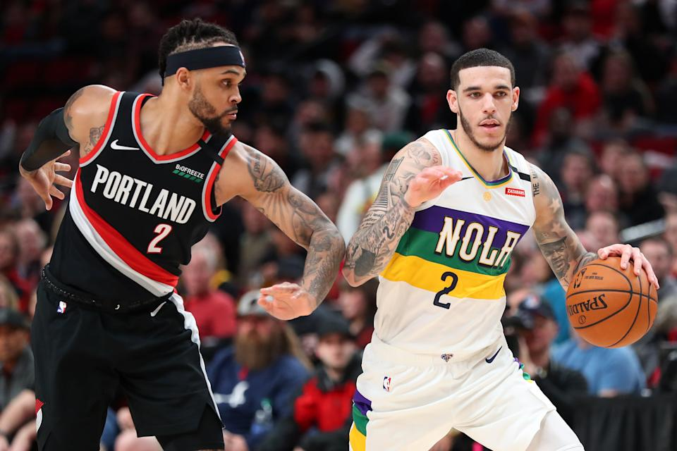 PORTLAND, OREGON - FEBRUARY 21: Lonzo Ball #2 of the New Orleans Pelicans dribbles against Gary Trent Jr. #2 of the Portland Trail Blazers in the third quarter during their game at Moda Center on February 21, 2020 in Portland, Oregon.  NOTE TO USER: User expressly acknowledges and agrees that, by downloading and or using this photograph, User is consenting to the terms and conditions of the Getty Images License Agreement. (Photo by Abbie Parr/Getty Images)