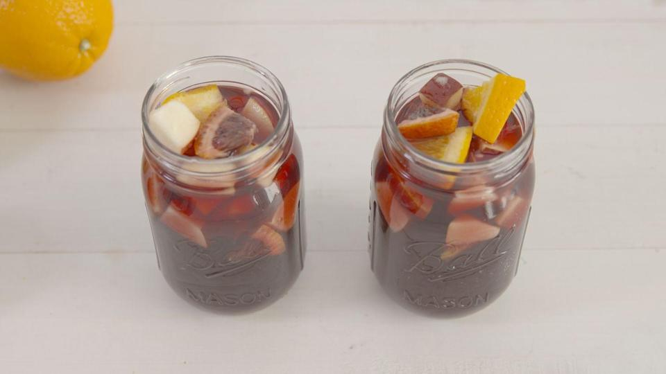 """<p>Get the party started by giving your sangria a fiery kick.</p><p>Get the recipe from <a href=""""https://www.delish.com/cooking/recipe-ideas/recipes/a46778/fireball-sangria-recipe/"""" rel=""""nofollow noopener"""" target=""""_blank"""" data-ylk=""""slk:Delish"""" class=""""link rapid-noclick-resp"""">Delish</a>.</p>"""