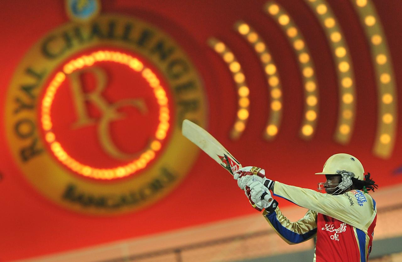 Royal Challengers Bangalore's batsman Chris Gayle plays a shot during the IPL Twenty20 cricket match between Royal Challengers Bangalore (RCB) and Pune Warriors (PW) at the M. Chinnaswamy Stadium in Bangalore on April 17, 2012. RCB is chasing a target of 183 runs set by PW with the loss of 6 wickets.  AFP PHOTO / Manjunath KIRAN RESTRICTED TO EDITORIAL USE. MOBILE USE WITHIN NEWS PACKAGE. (Photo credit should read Manjunath Kiran/AFP/Getty Images)