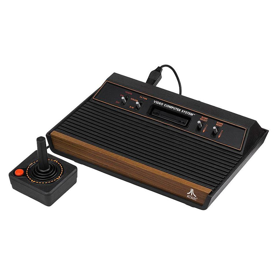 "<p><a class=""link rapid-noclick-resp"" href=""https://www.amazon.com/Atari-2600-Video-Computer-System-Console/dp/B000X8EYQU?tag=syn-yahoo-20&ascsubtag=%5Bartid%7C10063.g.34738490%5Bsrc%7Cyahoo-us"" rel=""nofollow noopener"" target=""_blank"" data-ylk=""slk:BUY NOW"">BUY NOW</a><br><br>The Atari 2600 gaming system launched in 1977. At first, it wasn't a huge success. Players were burnt out on <em>Pong</em> and lost interest in the $200 Video Computer System. It wasn't until the game <em>Adventure</em> was developed that sales for the Atari increased. <em>Adventure</em> was the first time a game had taken the player into a world bigger than the screen. Programmers started developing more adventure games, and by 1979, the Atari 2600 was the ""must-have"" Christmas gift of the year.<br></p>"