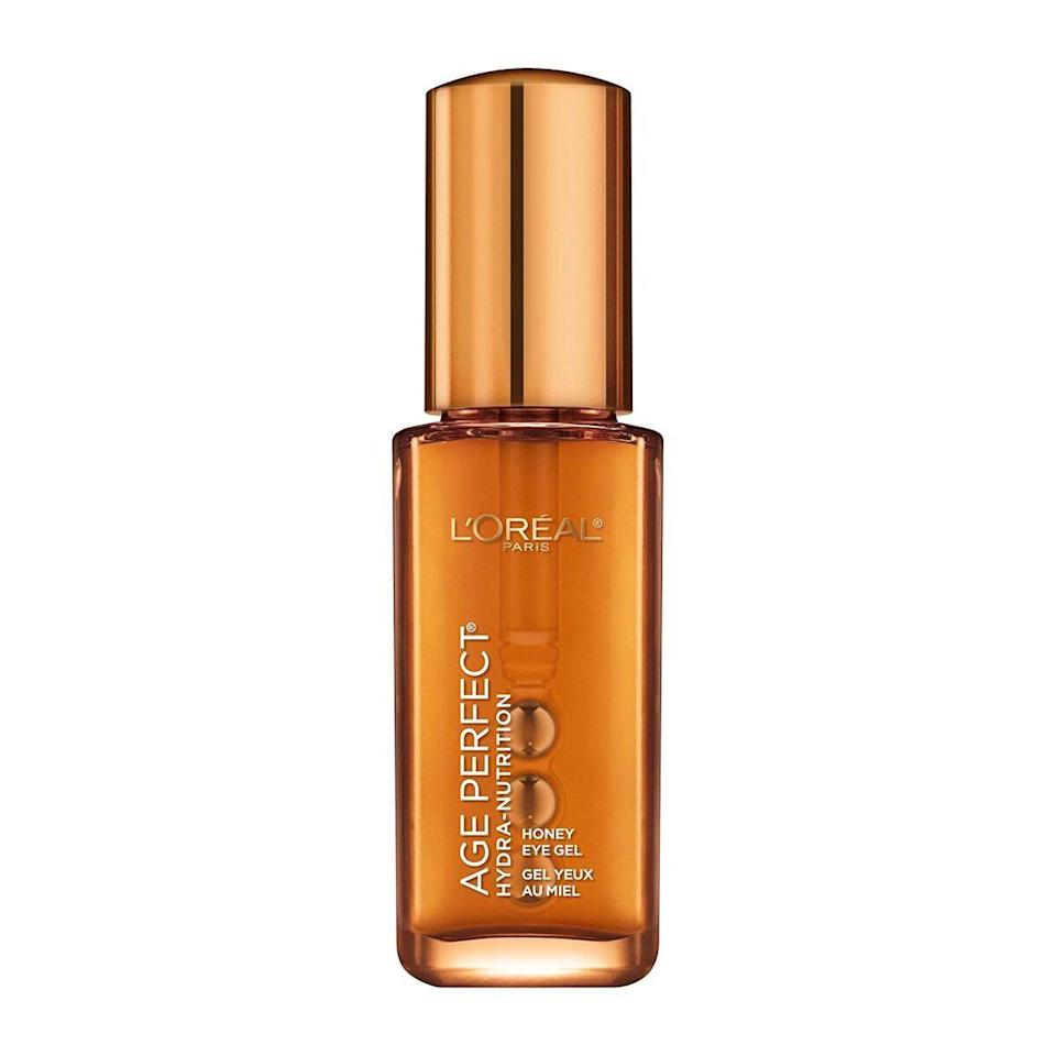 """Equipped with a cooling rollerball applicator, L'Oréal Paris' Age Perfect Hydra-Nutrition Manuka Honey Eye Gel won a 2020 <a href=""""https://www.allure.com/gallery/best-of-beauty-skin-care-product-winners?mbid=synd_yahoo_rss"""" rel=""""nofollow noopener"""" target=""""_blank"""" data-ylk=""""slk:Best of Beauty Award"""" class=""""link rapid-noclick-resp"""">Best of Beauty Award</a> for its depuffing and dark-circles-reducing abilities. The soothing combination of manuka honey, caffeine, and <a href=""""https://www.allure.com/story/what-is-hyaluronic-acid-skin-care?mbid=synd_yahoo_rss"""" rel=""""nofollow noopener"""" target=""""_blank"""" data-ylk=""""slk:hyaluronic acid"""" class=""""link rapid-noclick-resp"""">hyaluronic acid</a> is especially perfect for dry, mature skin. Gently pat in any excess product with your fingers."""