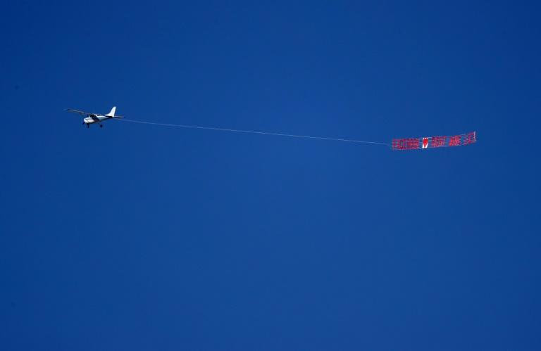 """A plane hired by the activist group Media Matters pulls a banner that reads """"Facebook loves right wing lies"""" as it flies over Facebook headquarters to press the point that the social network allows right-wing politicians to spread misinformation (AFP Photo/JUSTIN SULLIVAN)"""