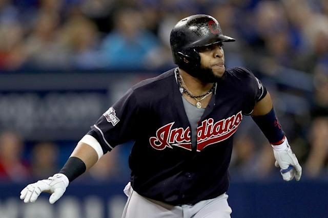 Carlos Santana of the Cleveland Indians hits a solo home run in the third inning against the Toronto Blue Jays during game five of the American League Championship Series (AFP Photo/Elsa)